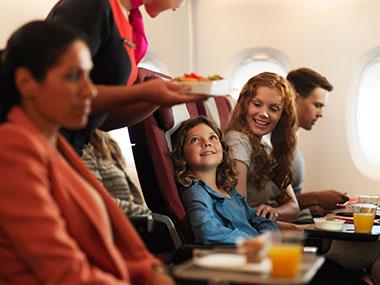 Family in Qantas Economy cabin