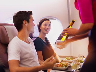 Couple enjoying a Qantas Premium Economy flight