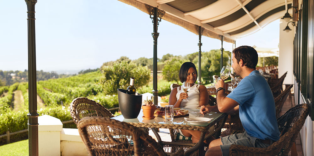 Couple drinking at a vineyard in South Australia