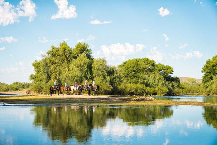 Four people on horseback Arizona