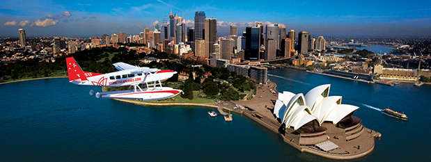 A sea plane flying over Sydney Harbour
