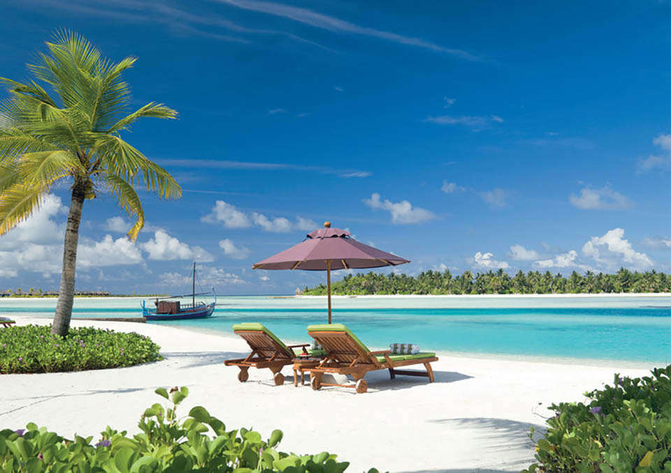 The beach and lagoon at Naladhu Resort Maldives