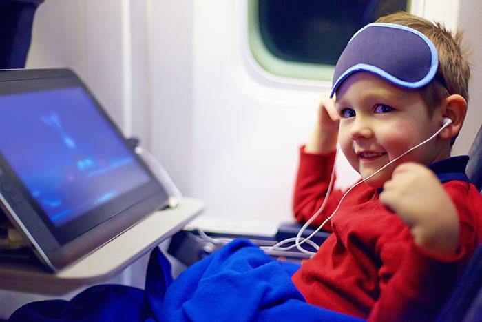Kid watching cartoons in-flight