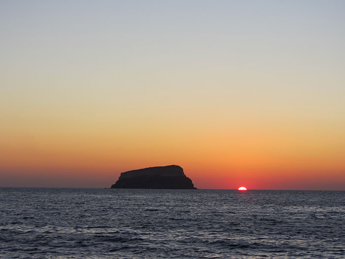 Sunset over Aspronisi (image: Angela Griffin)