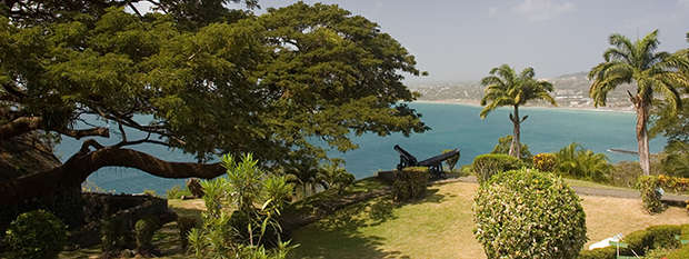 Cannons at Fort King George Tobago over the harbour of Scarborough