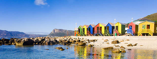 Colourful bathing boxes on St James Beach in Cape Town