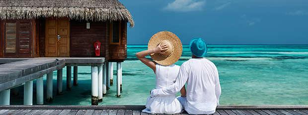 Couple overlook lagoon in the Maldives