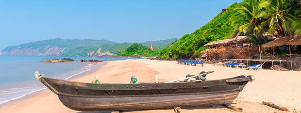 A boat on a beach in Goa