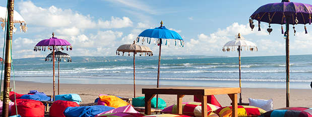 Umbrellas and pillows on the beach at Kuta in Bali
