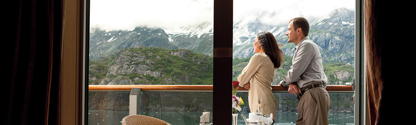 Couple on a balcony onboard Holland America