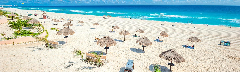 Beach umbrellas on a beach in Cancun, Mexico