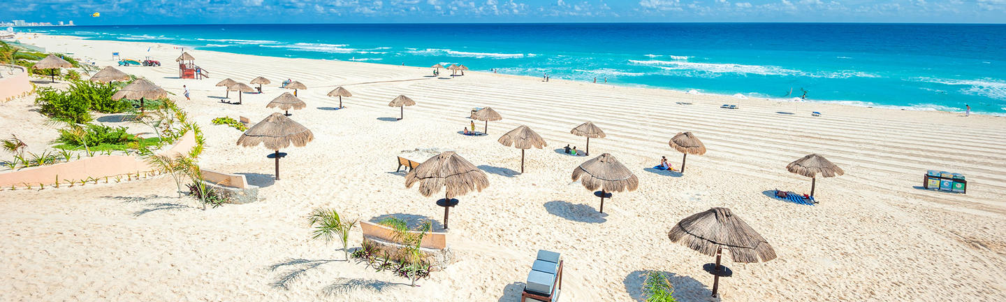 Beach umbrellas on a beach in Cancun, Mexico