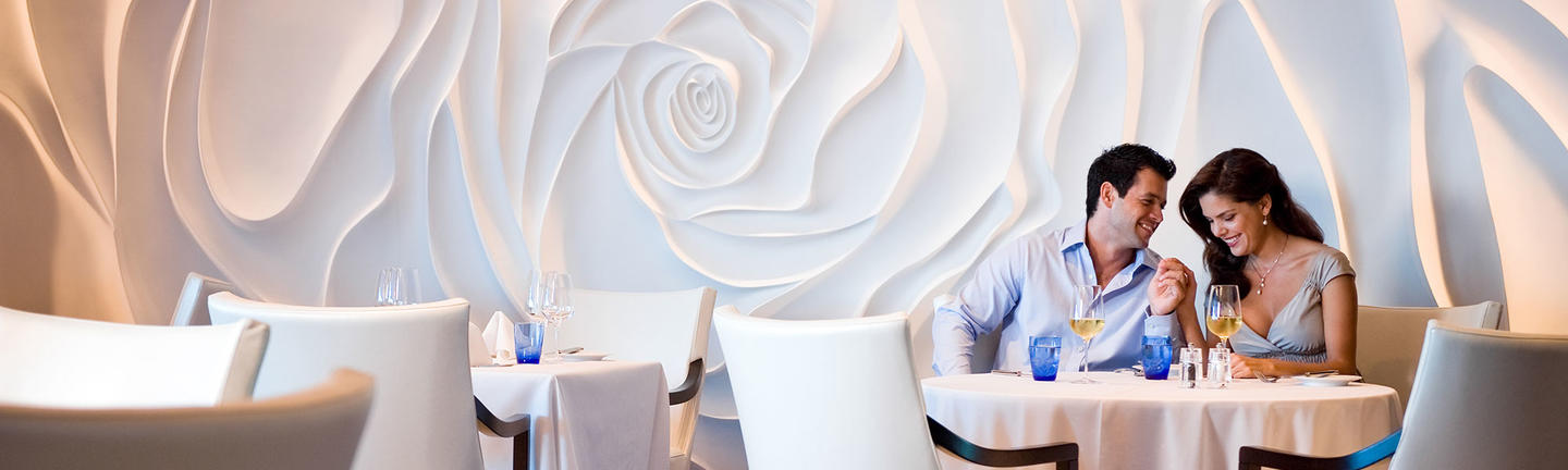 Couple at a restaurant onboard Celebrity Cruises