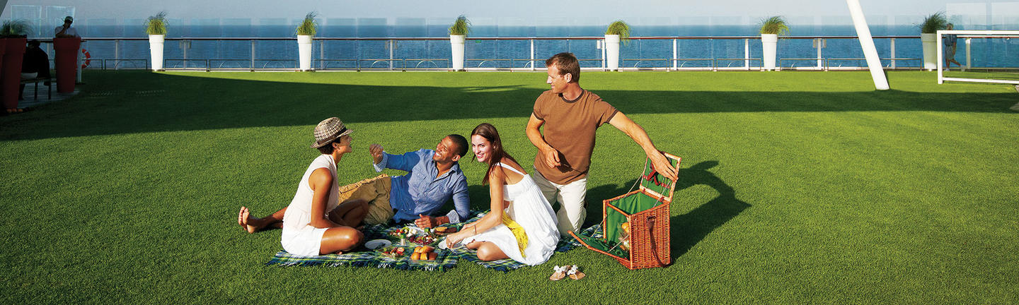 Couples at the Lawn Club onboard Celebrity Cruises
