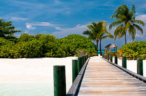 A jetty facing towards the beach in the Bahamas