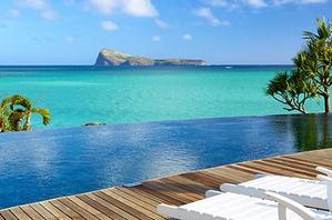 Lounges overlooking an infinity pool in Mauritius