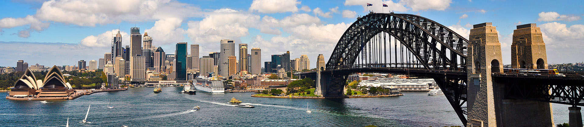 Sydney city skyline featuring the Harbour Bridge and Opera House