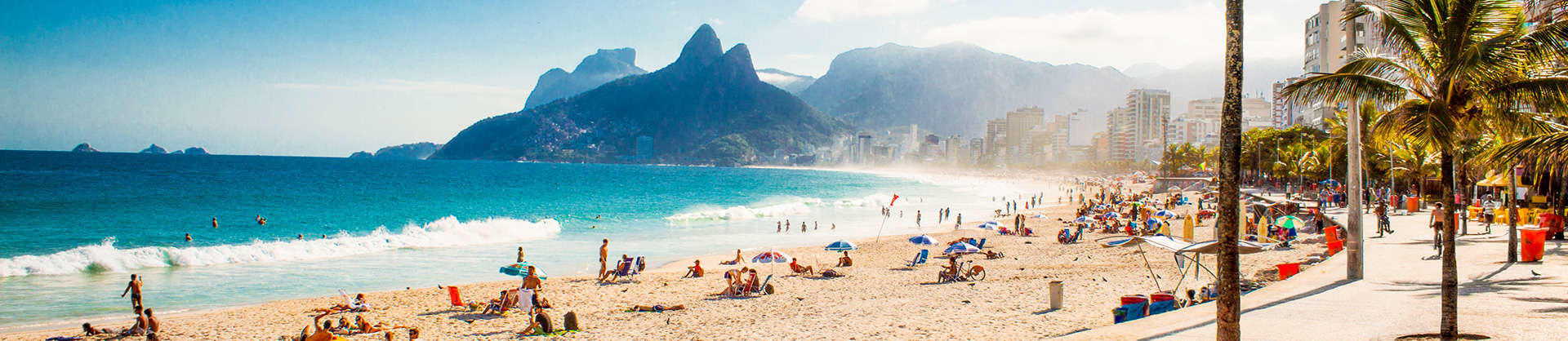 A view of Ipanema beach with mountains in the background