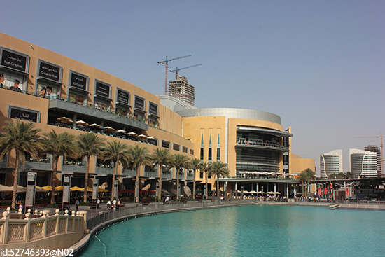 The vast Dubai Mall attracts millions of shopaholic tourists every year