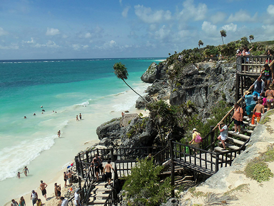 The cliff-top ruins and teetering palm trees at Tulum. ©Alexandra Gregg/Brad Cronin