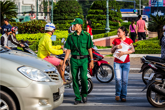 Crossing the road in Saigon – take it slow and steady (Image: Buffalo Tours)