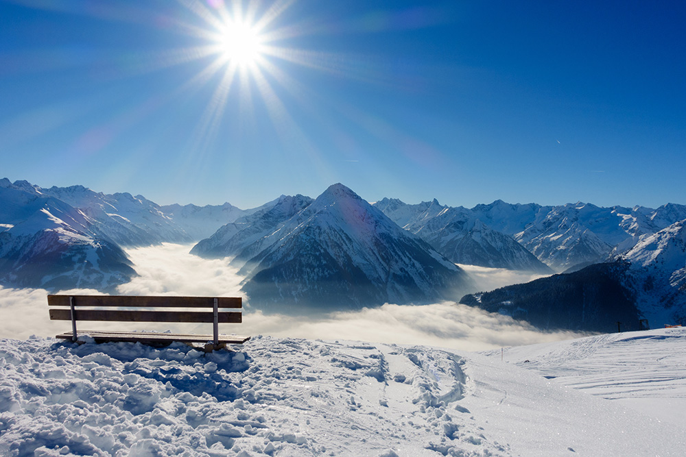 Bench with view over the winter Alps - Copy