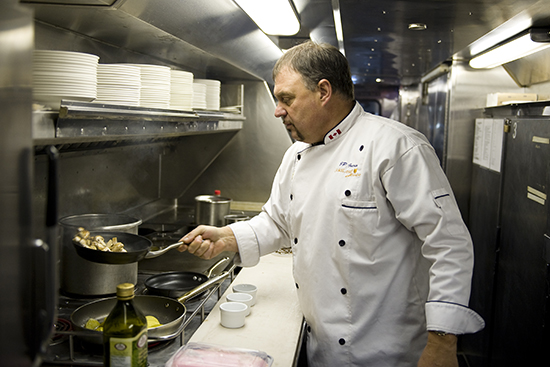 Chef JP cooking in one of the Rocky Mountaineer kitchens/galleys