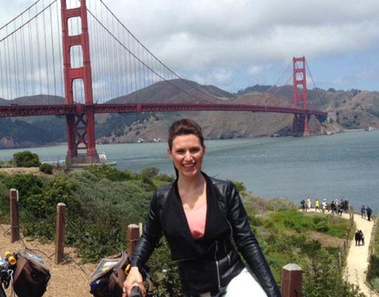Girl infront of Golden Gate Bridge