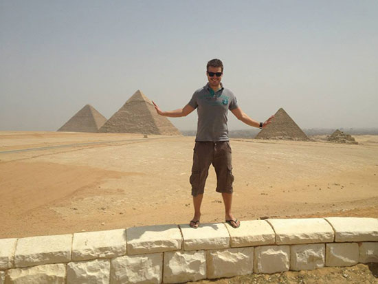 Man standing infront of pyramids in Egypt
