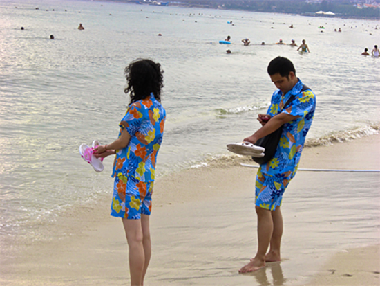 A Chinese couple rocking some floral fashion at the beach