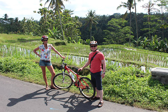 Suzy and hubby Barry bike riding in Bali