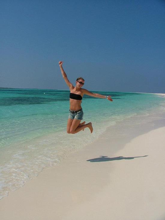 Suzy on a beach in the Maldives