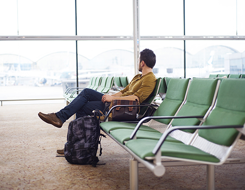 Man sitting in airport looking out the window