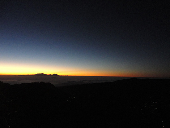 Sunlight penetrates the horizon around Mount Bromo (Image: Emma Brisdion)