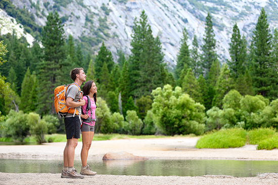 Couple hiking in Yosemite National Park, USA