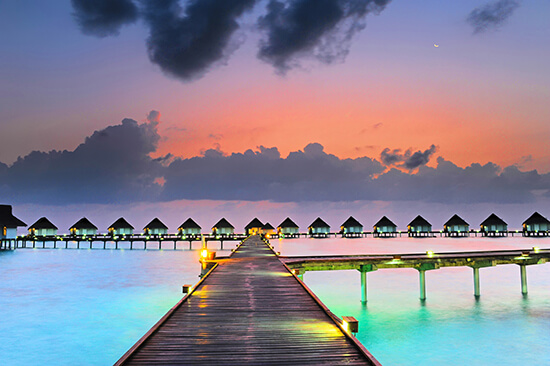 Overwater bungalows in the Maldives at sunset