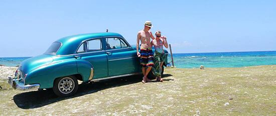 Becky in Cuba with a classic muscle car (Image: Becky Hales)