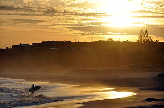 Surfer at Port Macquarie Lighthouse Beach