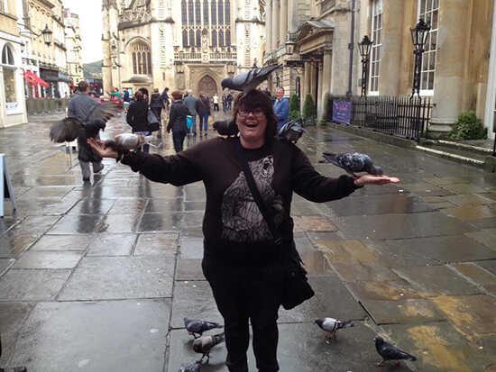 Feeding the pigeons in Bath, UK (Image: Amber Farley)