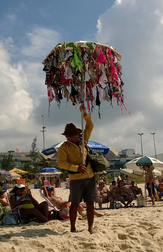 A bikini salesman on Barra da Tijuca beach (Image: Chris Steel)