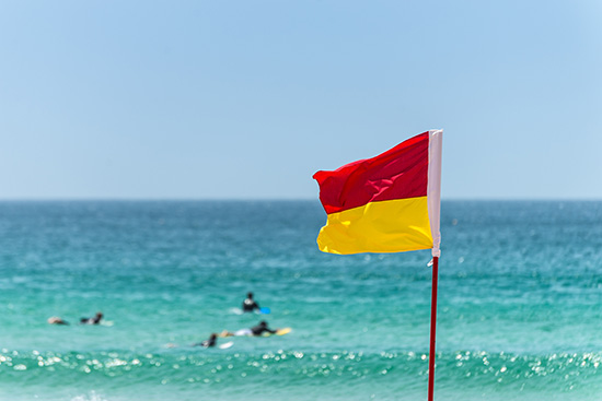 Always swim between the red and yellow flags