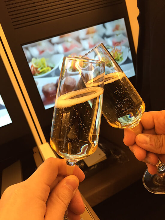 Champagne and food in Etihad Business Class is delicious