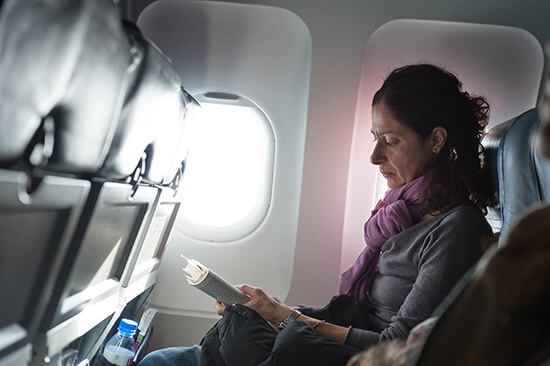 Woman reading on a plane