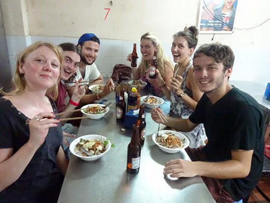Clara, Suzannah and travel friends eating local in Hanoi (Image: Clara Ramsdale)