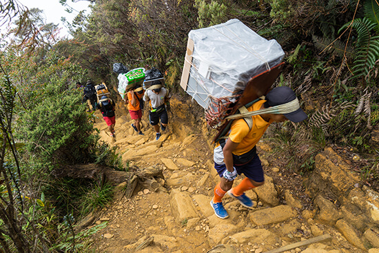The porters have A LOT to carry (Image: Ross Jennings)