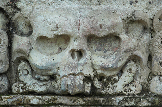 A detail from the aptly-named Temple of the Skull at Palenque