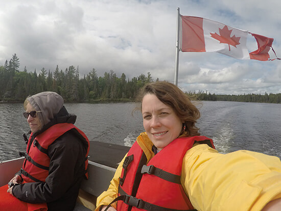 Me wrapped up on the boat searching for moose (image: Angela Griffin)