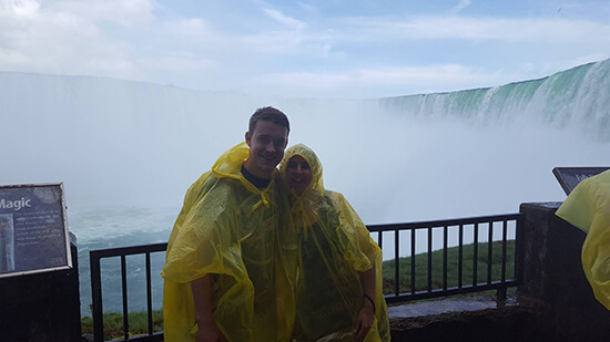 Brad and Alex in their yellow ponchos on the Journey Behind the Falls (image: Alexandra Gregg)