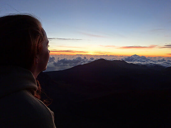 Erica watching the sunrise from the summit of Haleakala (image: Erica Davis)