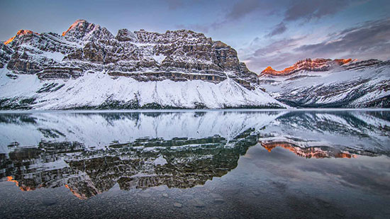 Bow Lake in Canada. By Adam of GettingStamped.com
